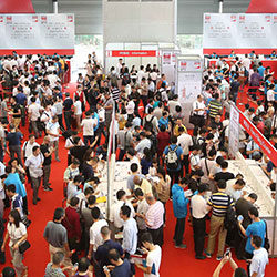 Visitors in the trade fair hall